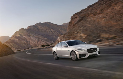 All-new Jaguar XF driving on mountain road