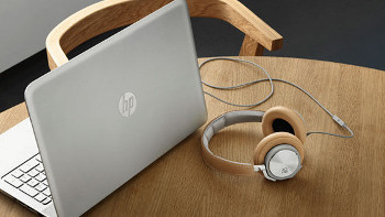 HP laptop shown with Bang & Olufsen headphones